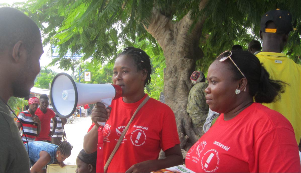 Awareness on protection and distribution of condoms by women leaders in Haiti.