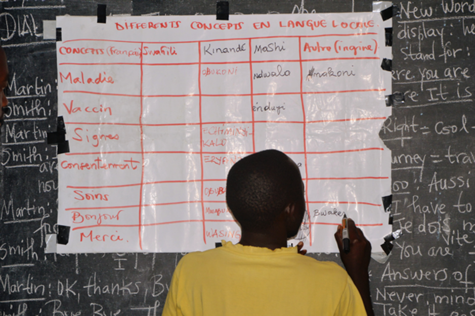 A child translates different words into local languages at a school in Goma, Democratic Republic of Congo. Credit: Translators without Borders